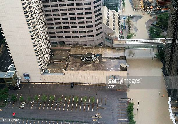 Rising water floods the Bow River in downtown Calgary on June 21 2013 As many as 100000 people have been forced from their homes but Mayor Naheed...