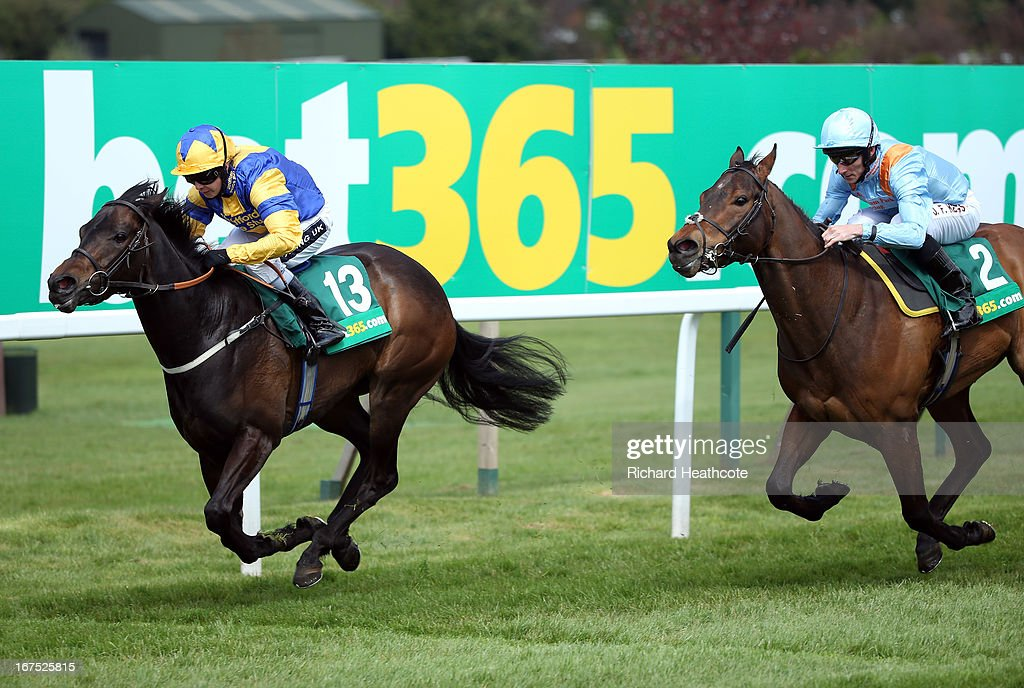Riskit Fora Biskit ridden by <a gi-track='captionPersonalityLinkClicked' href=/galleries/search?phrase=Hayley+Turner&family=editorial&specificpeople=253629 ng-click='$event.stopPropagation()'>Hayley Turner</a> wins The Bet365.com Handicap Stakes at Sandown Park on April 26, 2013 in Esher, England.