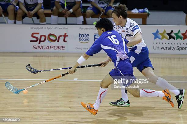 Risto Tollikko of Finland and Jumpei Oya of Japan challenge for the ball during the World University Championship Floorball match between Japan and...