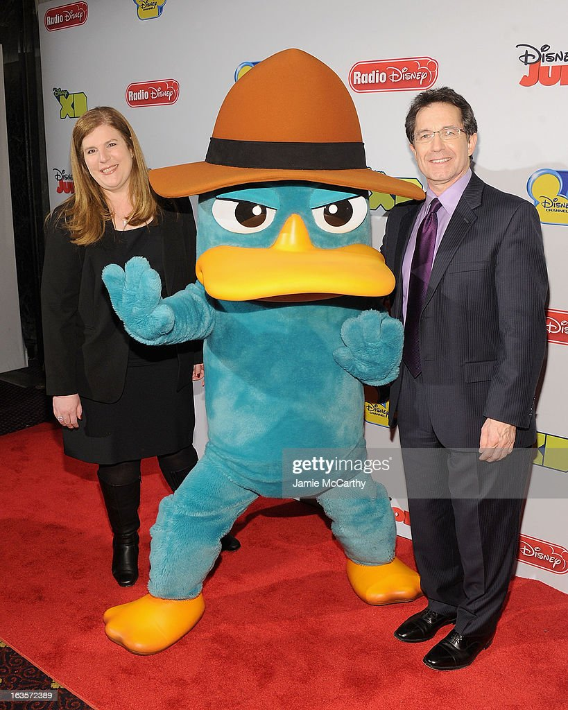 Rita Ferro ,executive Vice President of Disney media sales and marketing,Perry the Platypus and Gary Marsh,president and CEO of Disney channels attend the Disney Channel Kids Upfront 2013 at Hudson Theatre on March 12, 2013 in New York City.