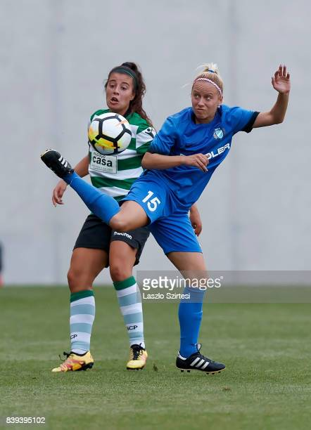 Rita Fontemanha of Sporting CP competes for the ball with Zsuzsanna Szabo of MTK Hungaria FC during the UEFA Women's Champions League Qualifying...