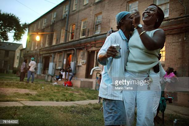 Rita Gardner who escaped the flooding on an air mattress because she cannot swim laughs in the BW Cooper housing project August 17 2007 in New...