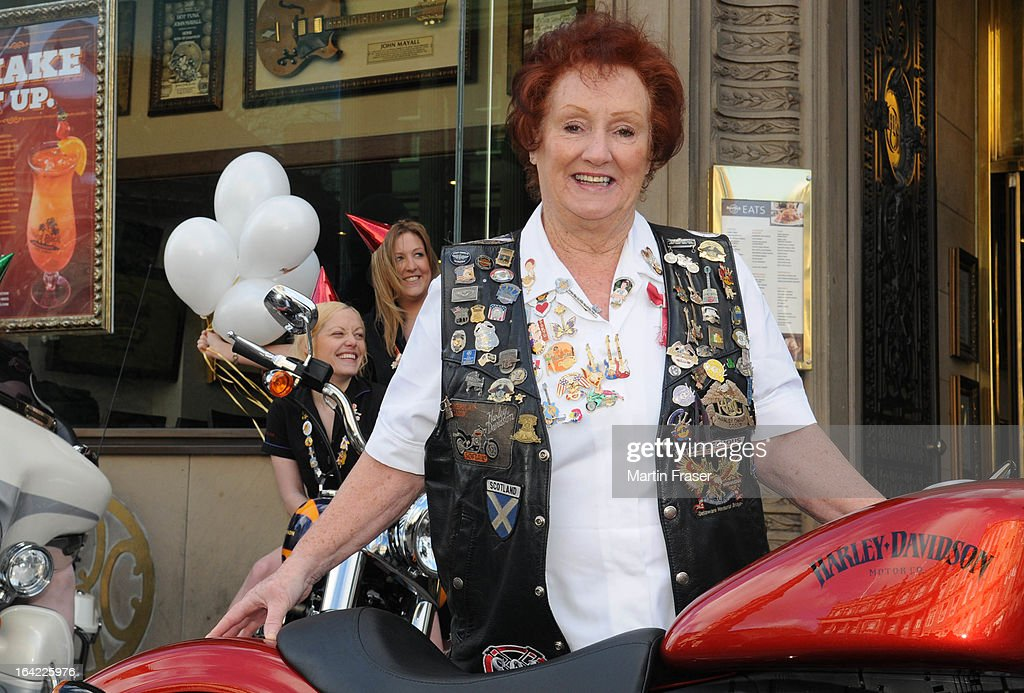 Rita Gilligan the Hard Rock Cafe's first UK waitress joined other Hard Rock waitress and a collection of classic Harley Davidson motorcycles to celebrate the 15th anniversary of The Hard Rock Cafe at Hard Rock Cafe on March 21, 2013 in Edinburgh, Scotland.