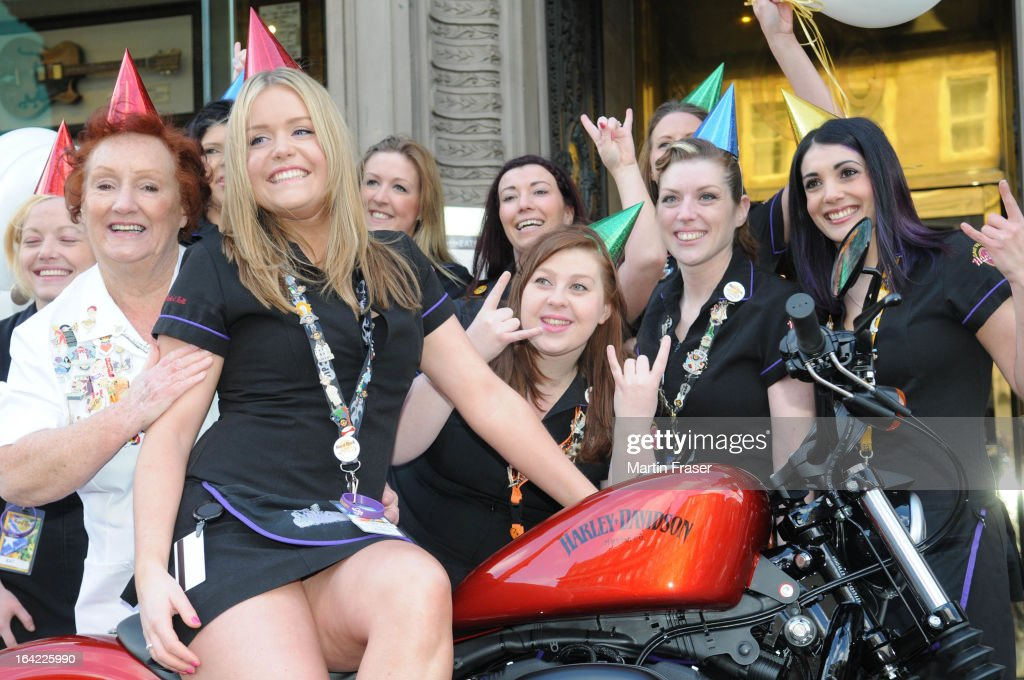 Rita Gilligan the Hard Rock Cafe's first UK waitress (L) joins Lauren Crannis and other Hard Rock waitresses and a collection of classic Harley Davidson motorcycles at Hard Rock Cafe on March 21, 2013 in Edinburgh, Scotland.