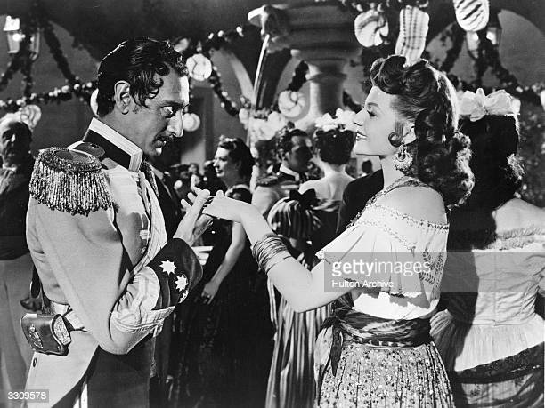 Rita Hayworth Arnold Moss share a romantic scene from 'The Loves Of Carmen' about a dragoon corporal in Seville who becomes enslaved by a gypsy kills...