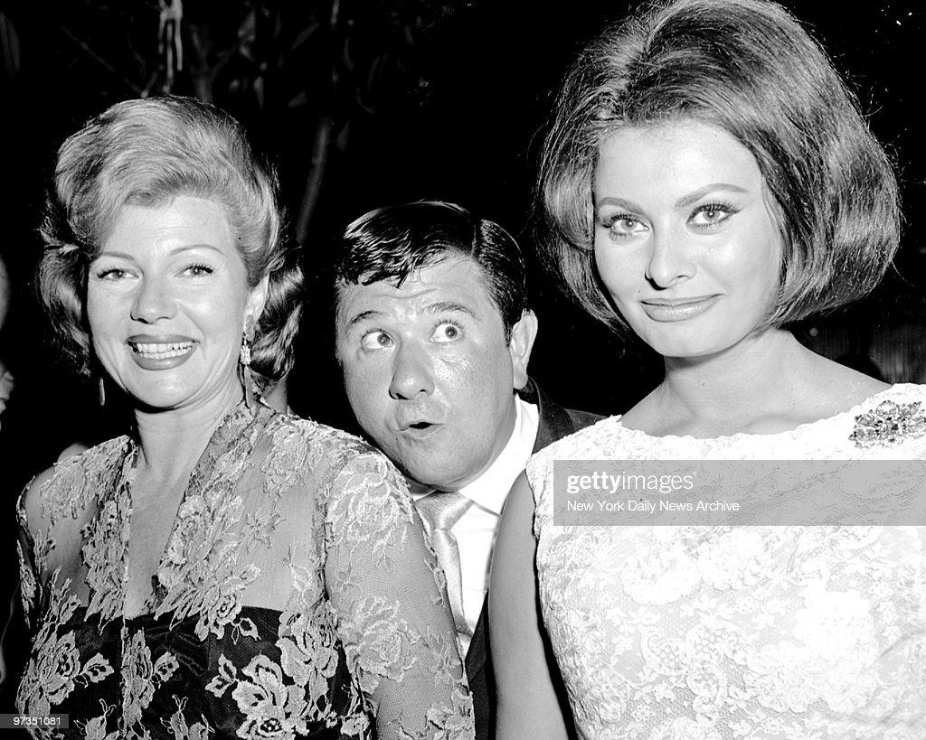 Rita Hayworth, Buddy Hackett, Sophia Loren (l. to r.) attending party for Loren at the Four Seasons.