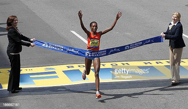 Rita Jeptoo of Kenya crosses the finish line to win the women's division of the 117th Boston Marathon on April 15 2013 in Boston Massachusetts