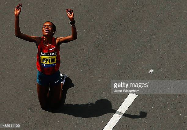 Rita Jeptoo of Kenya reacts after finishing in first place in the women's division with an official time of 22857 during the 2014 BAA Boston Marathon...