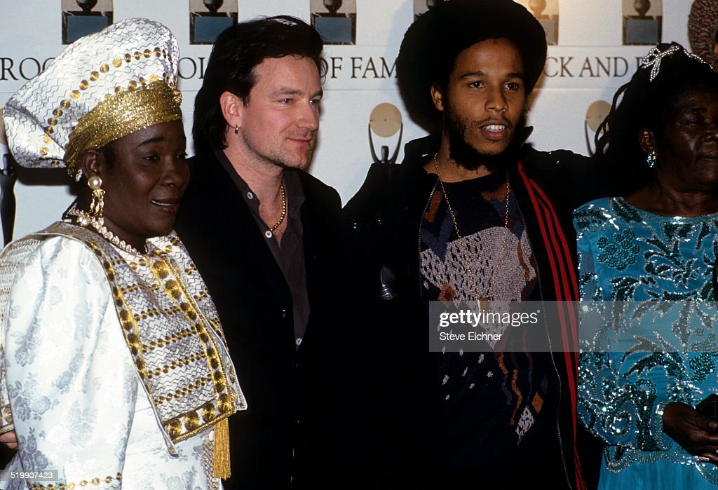 Rita Marley Bono of U2 and Ziggy Marley attend Rock and Roll Hall of Fame at Waldorf Astoria New York New York January 19 1994