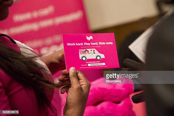 Rita McMiller a recruiter with Lyft left speaks with a job seeker during a National Career Fairs job fair in Chicago Illinois US on Thursday Jan 14...