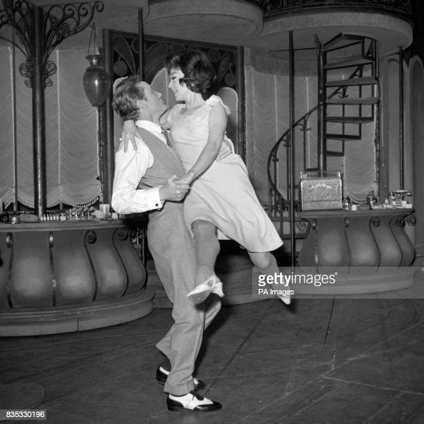 Rita Moreno is swept off her feet by Gary Miller as they rehearse a tango at the Lyric Theatre for a scene in the musical 'She Loves Me'