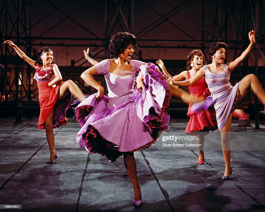 Rita Moreno, Puerto Rican actress, singer and dancer, wearing a short-sleeved lilac dress, dancing in a publicity image issued for the film adaptation of 'West Side Story', USA, 1961. The film musical, starring Moreno as Anita, is adapted from the stage production with music by Leonard Bernstein and Stephen Sondheim.