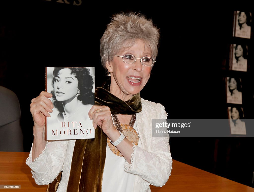 <a gi-track='captionPersonalityLinkClicked' href=/galleries/search?phrase=Rita+Moreno&family=editorial&specificpeople=210549 ng-click='$event.stopPropagation()'>Rita Moreno</a> signs copies of her new book '<a gi-track='captionPersonalityLinkClicked' href=/galleries/search?phrase=Rita+Moreno&family=editorial&specificpeople=210549 ng-click='$event.stopPropagation()'>Rita Moreno</a>: A Memoir' at Barnes & Noble bookstore at The Grove on March 14, 2013 in Los Angeles, California.