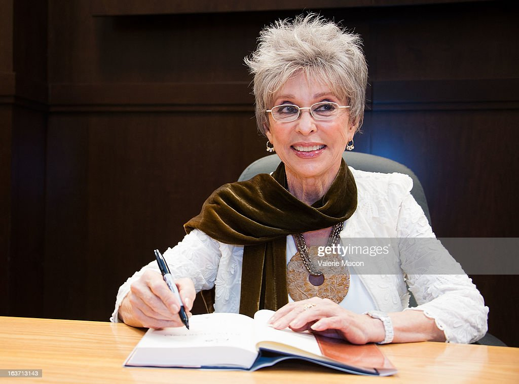 Rita Moreno signs her book during her Book Signing For 'Rita Moreno: A Memoir' at Barnes & Noble bookstore at The Grove on March 14, 2013 in Los Angeles, California.