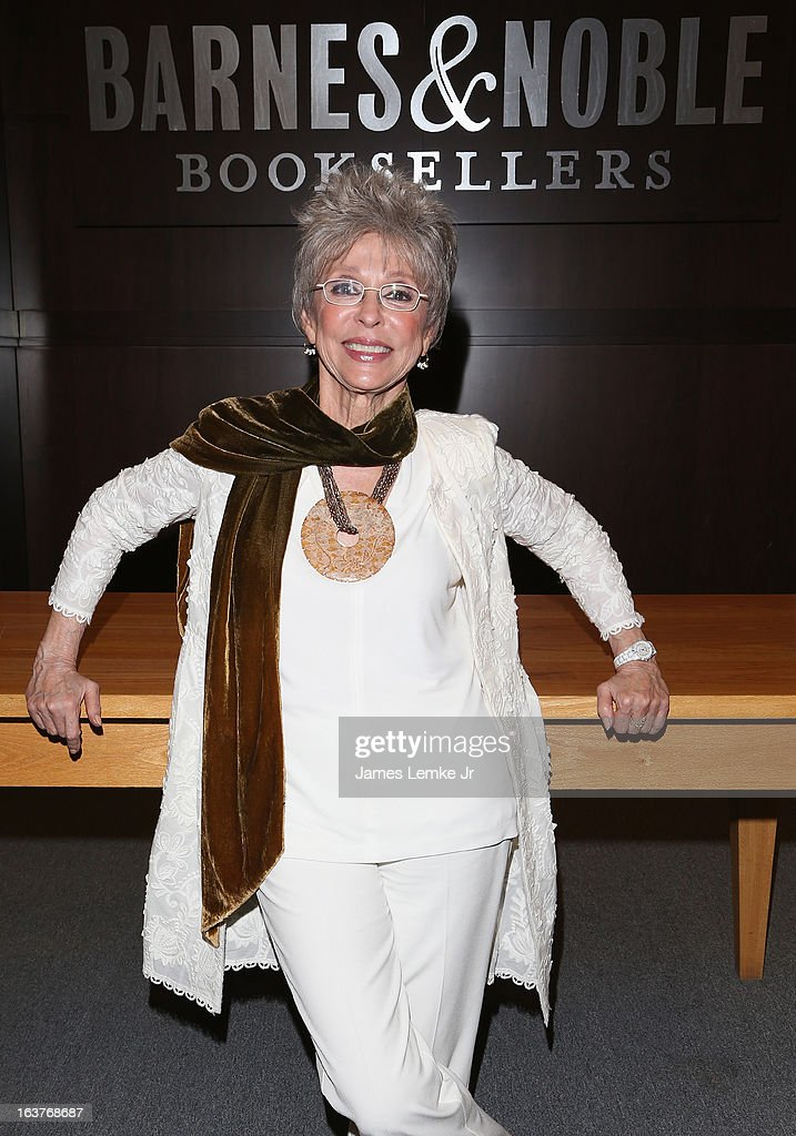 <a gi-track='captionPersonalityLinkClicked' href=/galleries/search?phrase=Rita+Moreno&family=editorial&specificpeople=210549 ng-click='$event.stopPropagation()'>Rita Moreno</a> signs her book during her Book Signing For '<a gi-track='captionPersonalityLinkClicked' href=/galleries/search?phrase=Rita+Moreno&family=editorial&specificpeople=210549 ng-click='$event.stopPropagation()'>Rita Moreno</a>: A Memoir' held at the Barnes & Noble bookstore at The Grove on March 14, 2013 in Los Angeles, California.