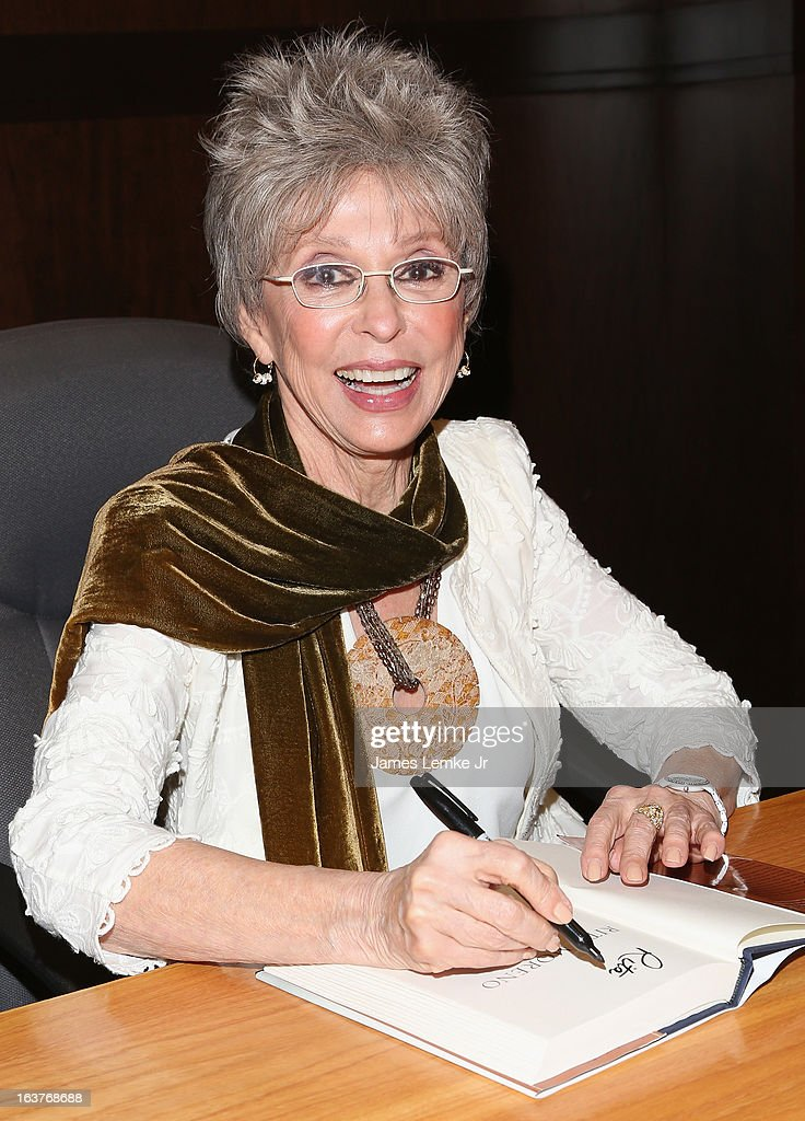 Rita Moreno signs her book during her Book Signing For 'Rita Moreno: A Memoir' held at the Barnes & Noble bookstore at The Grove on March 14, 2013 in Los Angeles, California.