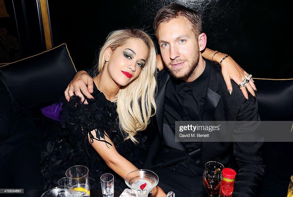 Rita Ora and Calvin Harris attend the Three Six Zero and Nokia MixRadio Party at Hakkasan on February 19 2014 in London England