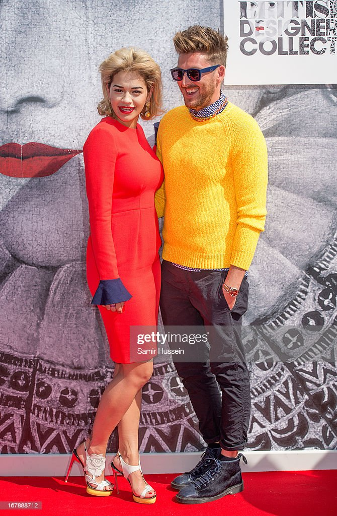 <a gi-track='captionPersonalityLinkClicked' href=/galleries/search?phrase=Rita+Ora&family=editorial&specificpeople=5686485 ng-click='$event.stopPropagation()'>Rita Ora</a> and <a gi-track='captionPersonalityLinkClicked' href=/galleries/search?phrase=Henry+Holland+-+Fashion+Designer&family=editorial&specificpeople=1637233 ng-click='$event.stopPropagation()'>Henry Holland</a> launch the British Designers' Collection at Bicester Village on May 2, 2013 in Bicester, England.