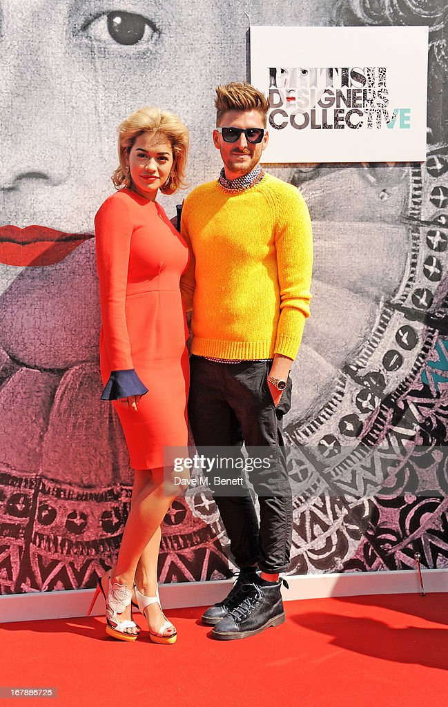 <a gi-track='captionPersonalityLinkClicked' href=/galleries/search?phrase=Rita+Ora&family=editorial&specificpeople=5686485 ng-click='$event.stopPropagation()'>Rita Ora</a> (L) and <a gi-track='captionPersonalityLinkClicked' href=/galleries/search?phrase=Henry+Holland+-+Fashion+Designer&family=editorial&specificpeople=1637233 ng-click='$event.stopPropagation()'>Henry Holland</a> pose as <a gi-track='captionPersonalityLinkClicked' href=/galleries/search?phrase=Rita+Ora&family=editorial&specificpeople=5686485 ng-click='$event.stopPropagation()'>Rita Ora</a> launches the British Designers' Collection at Bicester Village on May 2, 2013 in Bicester, England.