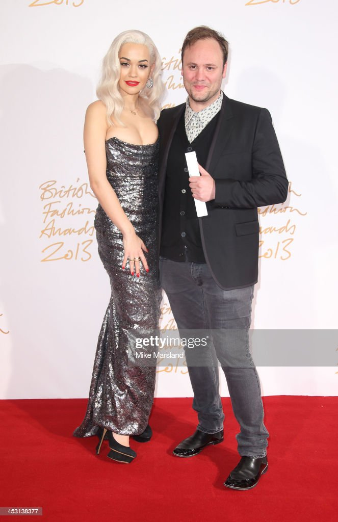 Rita Ora and Nicholas Kirkwood poses in the winners room at the British Fashion Awards 2013 at London Coliseum on December 2, 2013 in London, England.