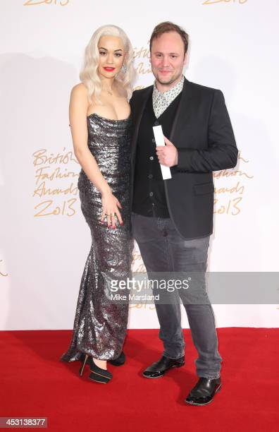 Rita Ora and Nicholas Kirkwood poses in the winners room at the British Fashion Awards 2013 at London Coliseum on December 2 2013 in London England