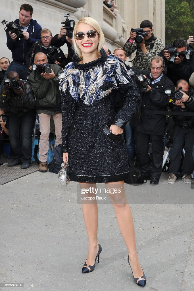 <a gi-track='captionPersonalityLinkClicked' href=/galleries/search?phrase=Rita+Ora&family=editorial&specificpeople=5686485 ng-click='$event.stopPropagation()'>Rita Ora</a> arrives at Chanel Fashion Show during Paris Fashion Week Womenswear SS14 - Day 8 on October 1, 2013 in Paris, France.