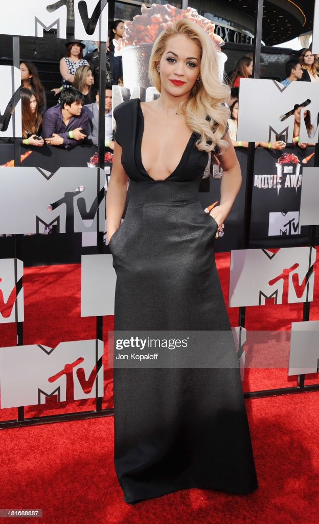 <a gi-track='captionPersonalityLinkClicked' href=/galleries/search?phrase=Rita+Ora&family=editorial&specificpeople=5686485 ng-click='$event.stopPropagation()'>Rita Ora</a> arrives at the 2014 MTV Movie Awards at Nokia Theatre L.A. Live on April 13, 2014 in Los Angeles, California.