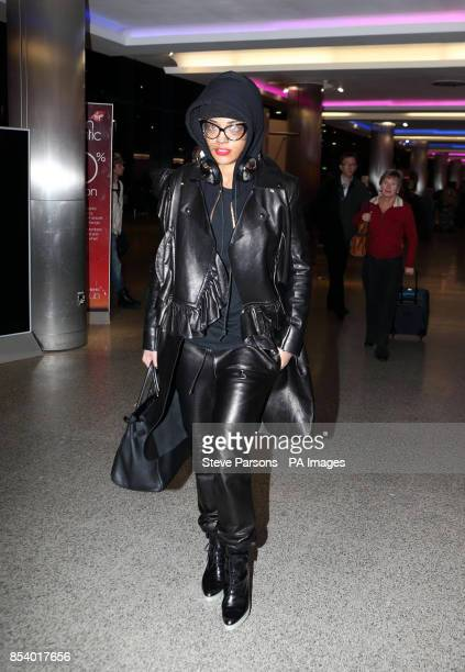Rita Ora arrives to board a flight at Heathrow Airport London