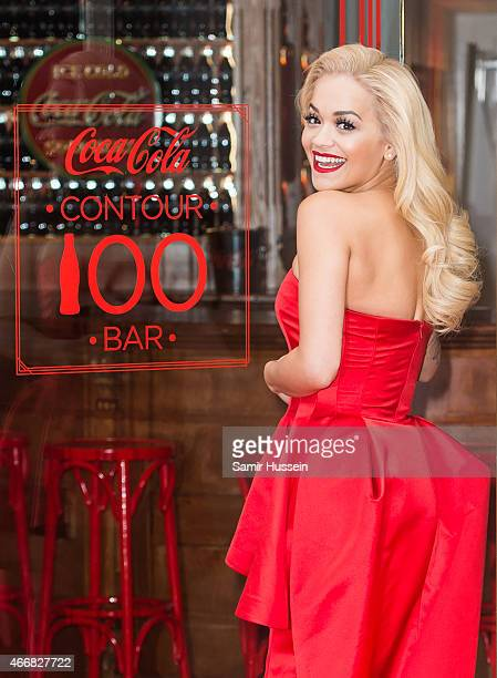 Rita Ora attends a photocall to celebrate 100 years of the CocaCola Contour Bottle at the CocaCola Contour Centenary Bar on March 19 2015 in London...