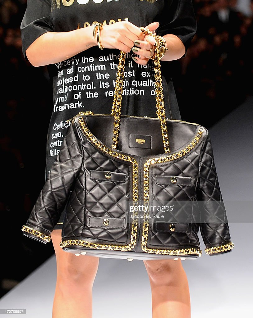 Rita Ora (bag detail) attends the Moschino show as a part of Milan Fashion Week Womenswear Autumn/Winter 2014 on February 20, 2014 in Milan, Italy.