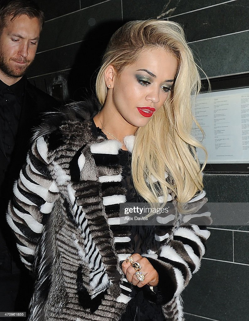 Rita Ora & Calvin Harris seen leaving Hakasan Restaurant in london after roc national party. Rita and calvin are rumored to be engaged. on February 19, 2014 in London, England.