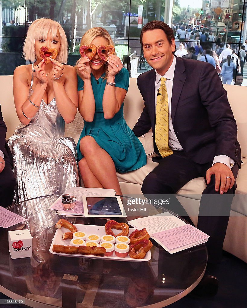 Rita Ora, Elisabeth Hasselbeck, and Clayton Morris have fun with cronuts on 'Fox & Friends' at the FOX Studios on August 19, 2014 in New York City.