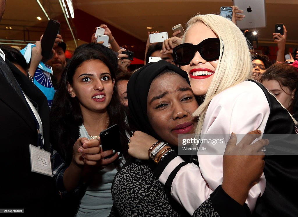 Rita Ora is embraced by a fan as she launches her adidas Originals Rita Ora SS16 collection at the Originals store at Dubai Mall on February 10, 2016 in Dubai, United Arab Emirates.