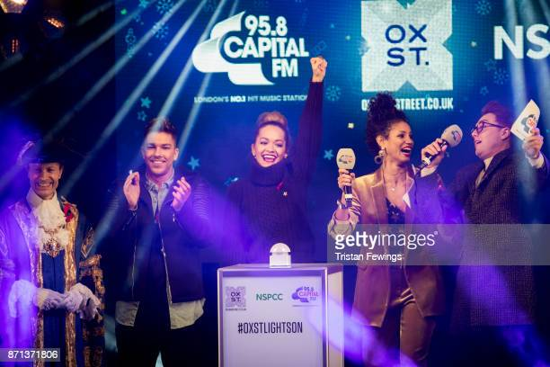 Rita Ora is joined on stage by Matt Terry Vick Hope and Roman Kemp as she switches on the lights during the Oxford Street Christmas Lights Switch On...