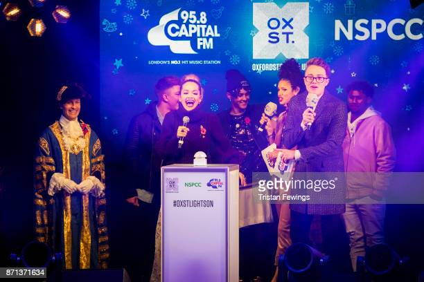 Rita Ora is joined on stage by Matt Terry Vick Hope Roman Kemp and 5 After Midnight as she switches on the lights during the Oxford Street Christmas...