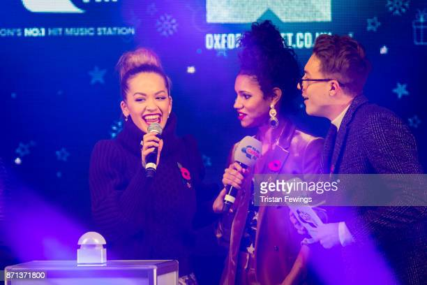 Rita Ora is joined on stage by Vick Hope and Roman Kemp as she switches on the lights during the Oxford Street Christmas Lights Switch On at Oxford...