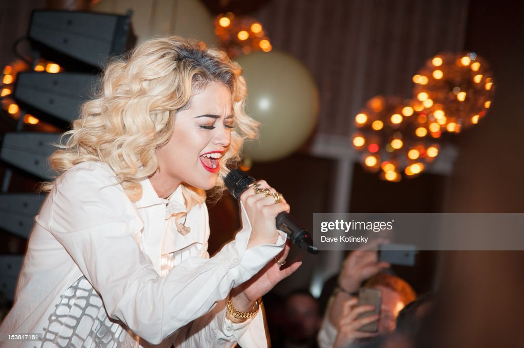 <a gi-track='captionPersonalityLinkClicked' href=/galleries/search?phrase=Rita+Ora&family=editorial&specificpeople=5686485 ng-click='$event.stopPropagation()'>Rita Ora</a> performs at the Absolut Tune Launch Party at The Top of The Standard on October 9, 2012 in New York City.