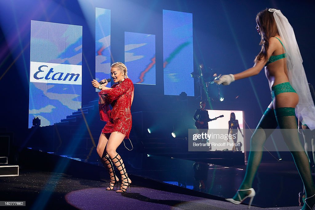 Rita Ora (L) performs during the Etam Live Show Lingerie at Bourse du Commerce on February 26, 2013 in Paris, France.