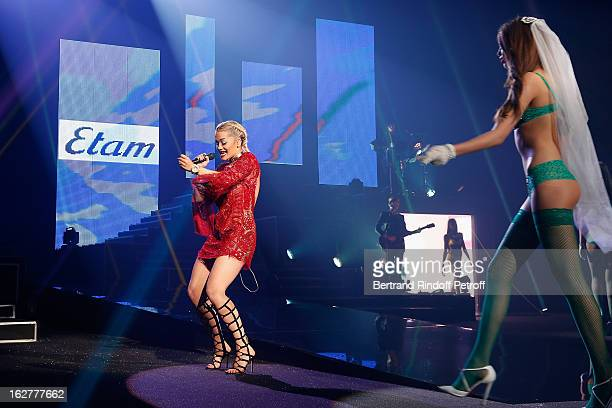 Rita Ora performs during the Etam Live Show Lingerie at Bourse du Commerce on February 26 2013 in Paris France