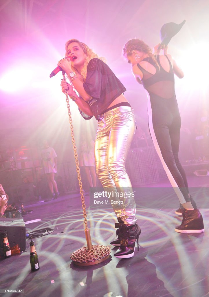 Rita Ora (L) performs with Cara Delevingne at Club DKNY in celebration of #DKNYARTWORKS hosted by Cara Delevingne with special performances by Rita Ora and Iggy Azalea at The Fire Station on June 12, 2013 in London, England.