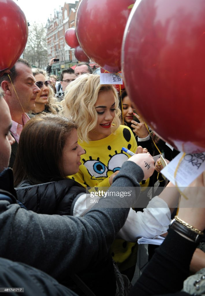 Rita Ora pictured promoting her latest single in Leicester Square with fans on March 31 2014 in London England