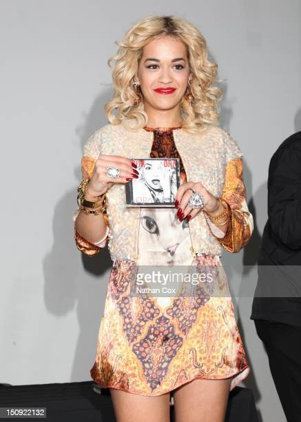 Rita Ora poses during a signing for her debut album 'Ora' at HMV on August 29 2012 in Manchester England
