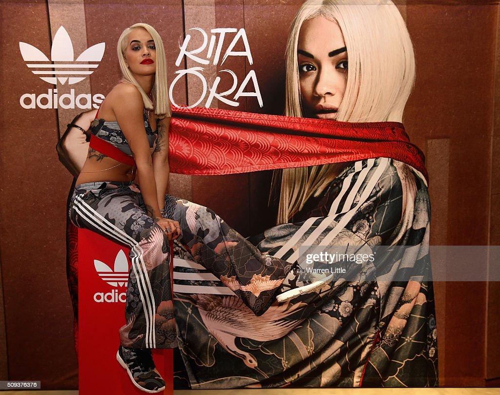 Rita Ora poses for a picture as she launches her adidas Originals Rita Ora SS16 collection at the Originals store at Dubai Mall on February 10, 2016 in Dubai, United Arab Emirates.