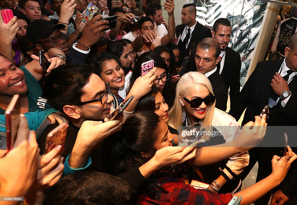 Rita Ora poses for pictures with fans as she launches her adidas Originals Rita Ora SS16 collection at the Originals store at Dubai Mall on February 10, 2016 in Dubai, United Arab Emirates.