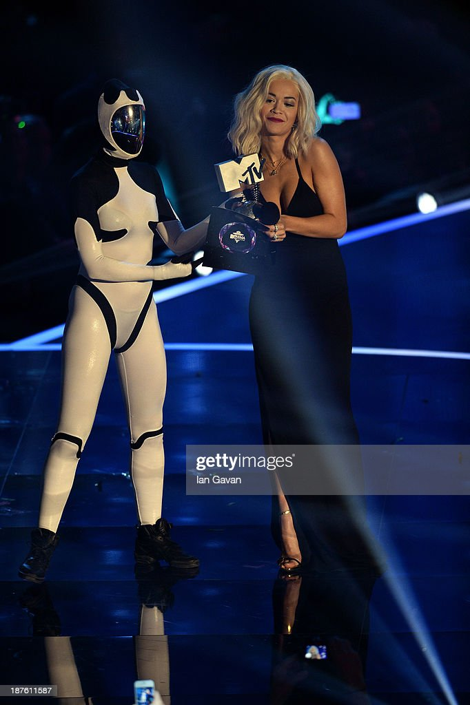 Rita Ora presents the Best Hip Hop award to Eminem (not pictured) onstage during the MTV EMA's 2013 at the Ziggo Dome on November 10, 2013 in Amsterdam, Netherlands.