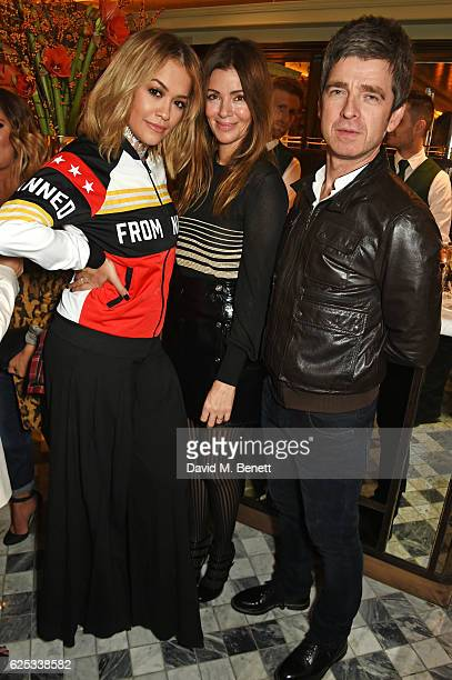 RIta Ora Sara Macdonald and Noel Gallagher attend the adidas Originals by Rita Ora dinner at The Ivy Chelsea Garden on November 23 2016 in London...