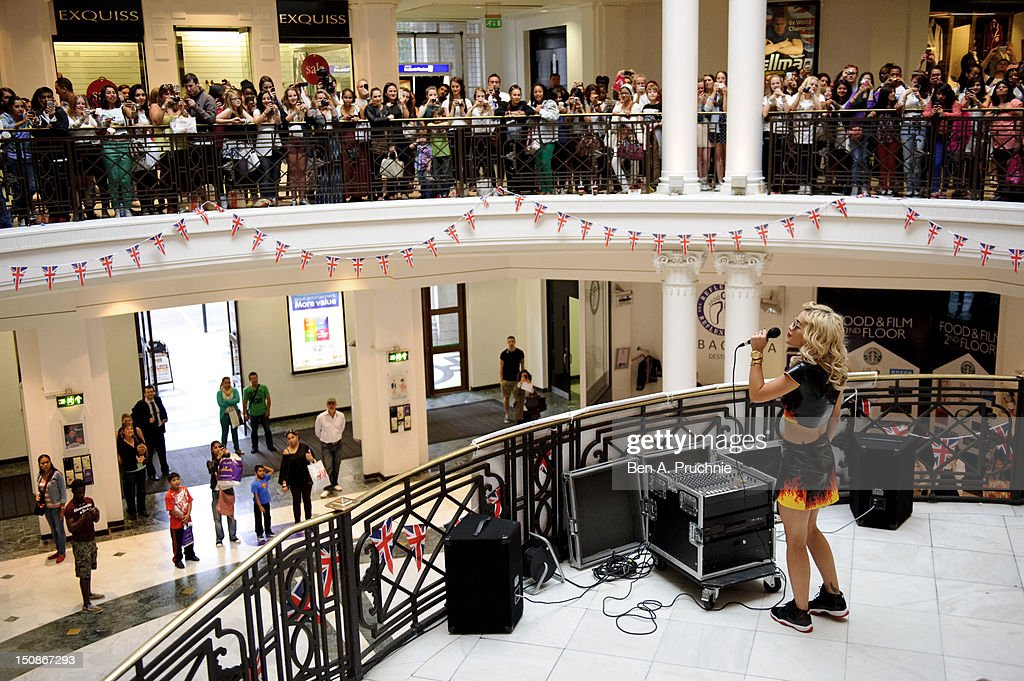 Rita Ora signs copies of her album 'Ora' at HMV Bayswater on August 28, 2012 in London, England.
