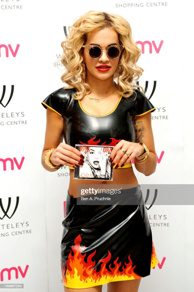 <a gi-track='captionPersonalityLinkClicked' href=/galleries/search?phrase=Rita+Ora&family=editorial&specificpeople=5686485 ng-click='$event.stopPropagation()'>Rita Ora</a> signs copies of her album 'Ora' at HMV Bayswater on August 28, 2012 in London, England.