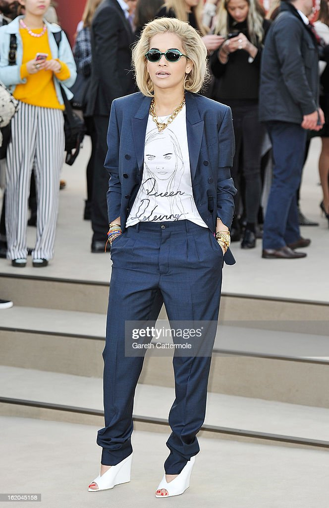 Rita Ora wearing Burberry, arrives at the Burberry Prorsum Autumn Winter 2013 Womenswear Show on February 18, 2013 in London, England.