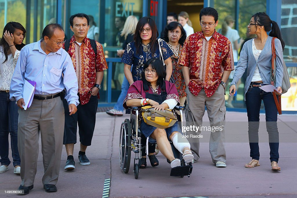Rita Paulina who was wounded during the shooting at the screening of The Dark Knight Rises leaves in a wheelchair with her family from the Arapahoe County Courthouse after attending an arraignment hearing for suspect James Holmes on July 30, 2012 in Centennial, Colorado. James Holmes, 24, who is accused of killing 12 people and injuring 58 in a shooting spree July 20, during a screening of 'The Dark Knight Rises.' in Aurora, Colorado was charged with 24 counts of first-degree murder and 116 counts of attempted murder.